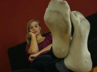 Los calcetines sucios del ball_white toman el pelo