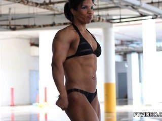 Latina muscular girl flexing
