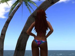 Venise en bikini al borde de la playa